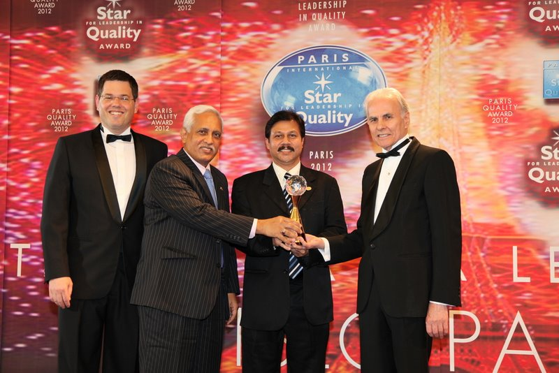 Managing Director & CEO Ahsan Parvez and Deputy Managing Director & COO Noor-e-Khoda Abdul Mobin of Emerging Credit Rating Ltd receiving the ISLQ International Star for Leadership in Quality Award from President of BID Jose E Prieto at a Paris hotel in 2012.